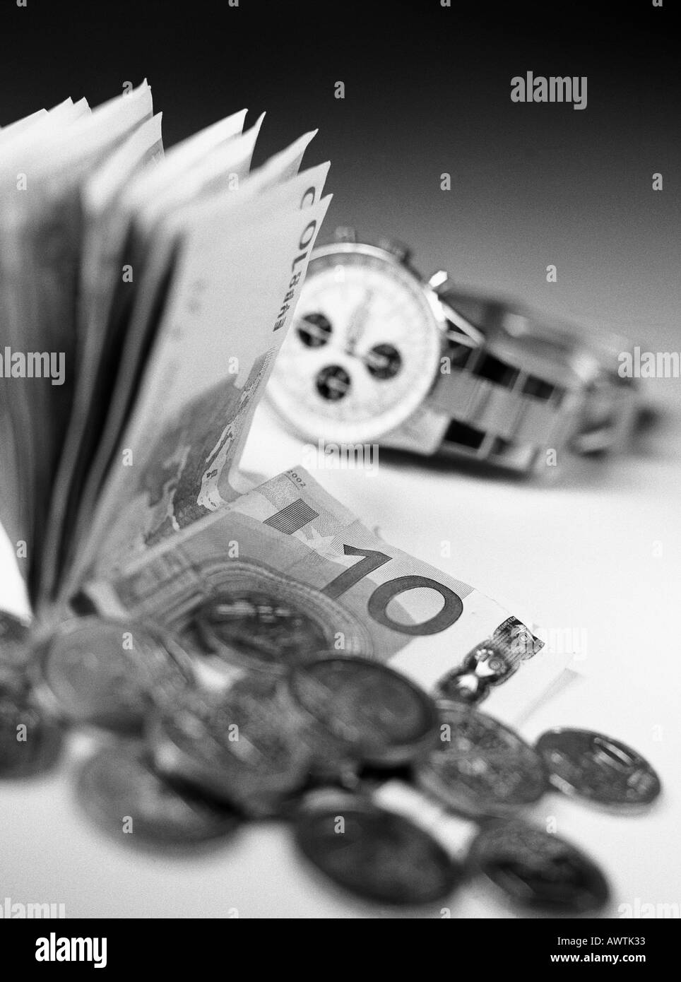 Money and watch, close-up Stock Photo