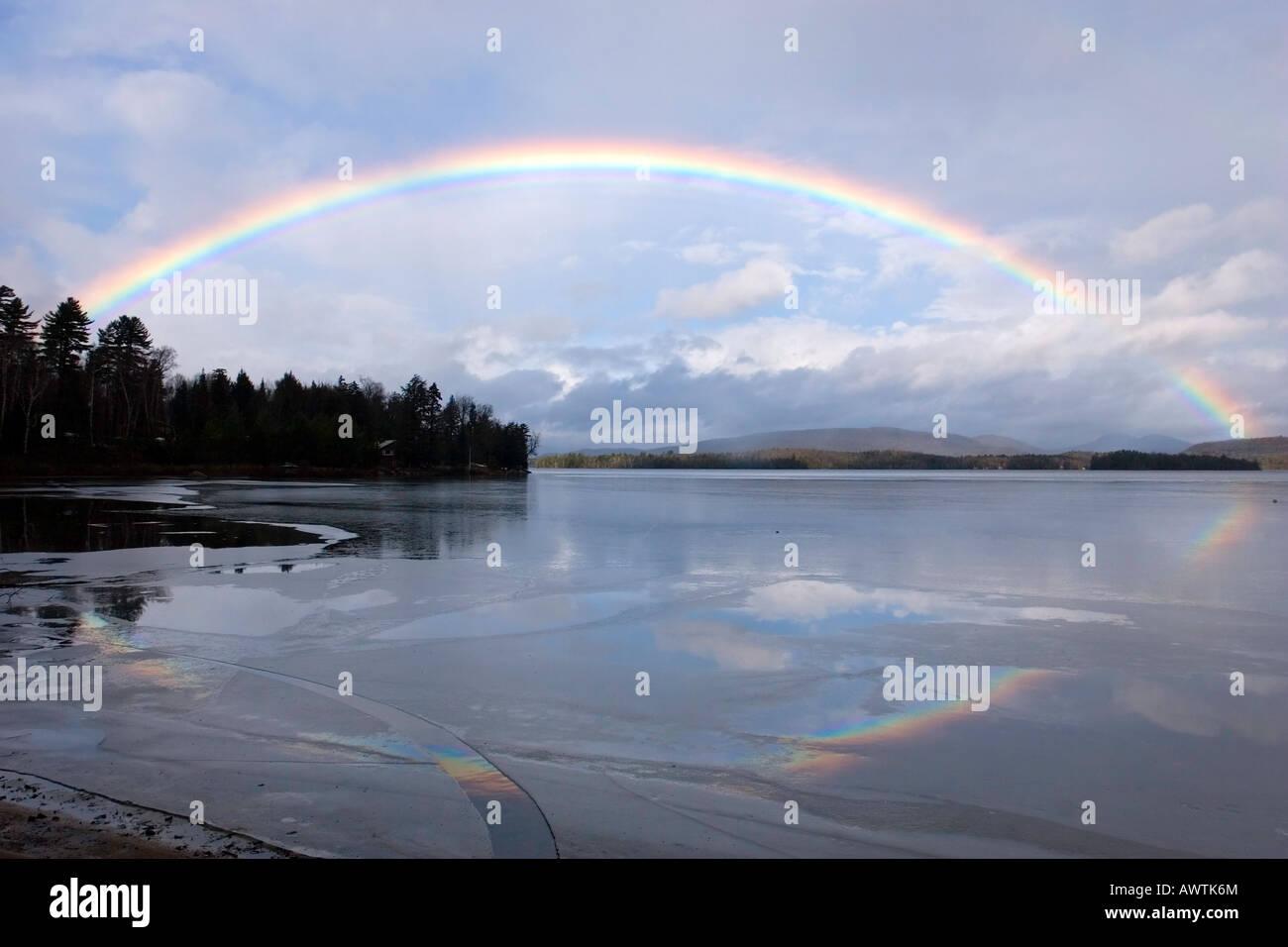 Full Rainbow over Lake Sacandaga, Adirondack Mountains, New York, United States - Stock Image