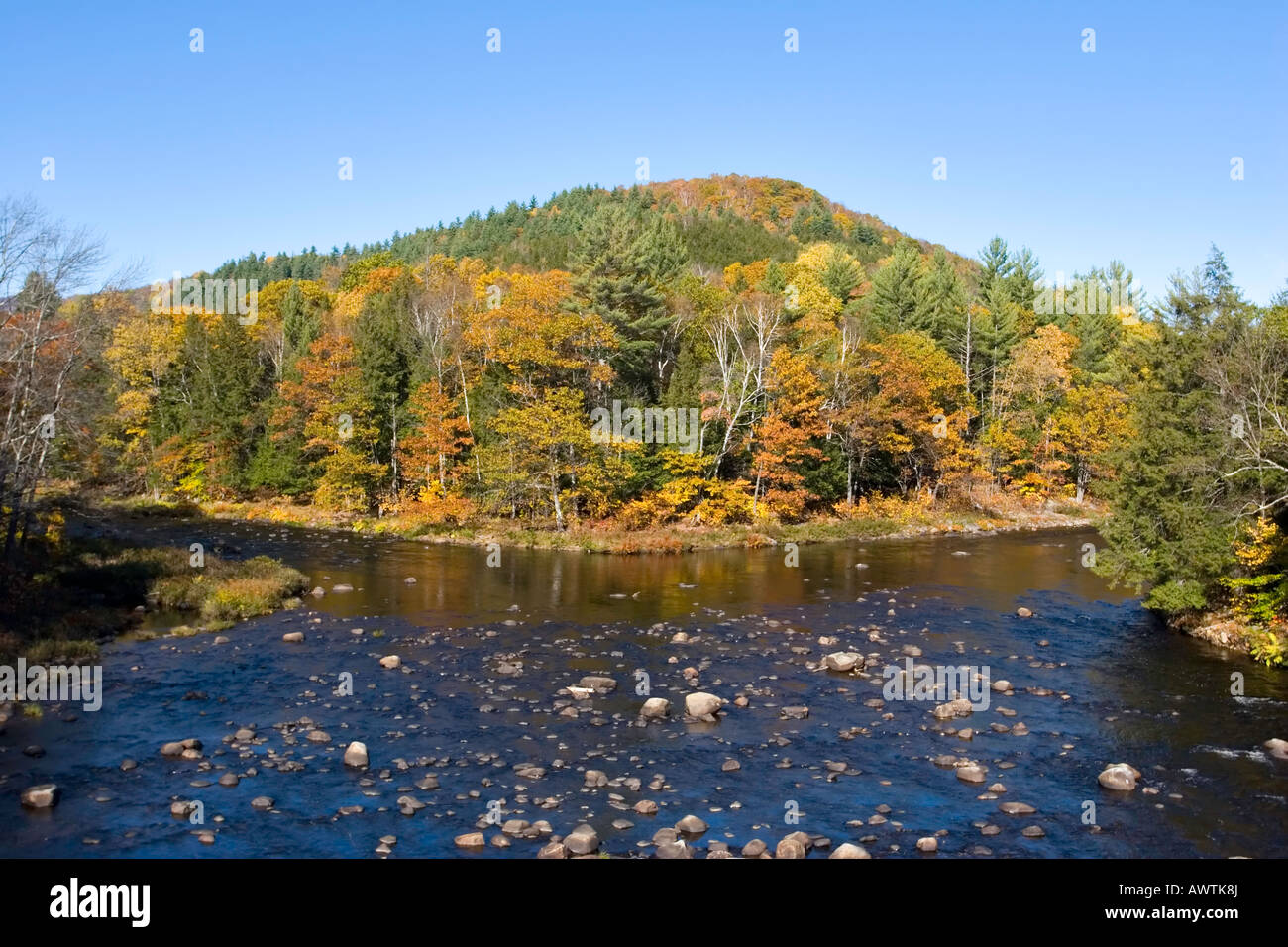 East and west branches of the Sacandaga River joining, Adirondack Mountains, New York, United States - Stock Image