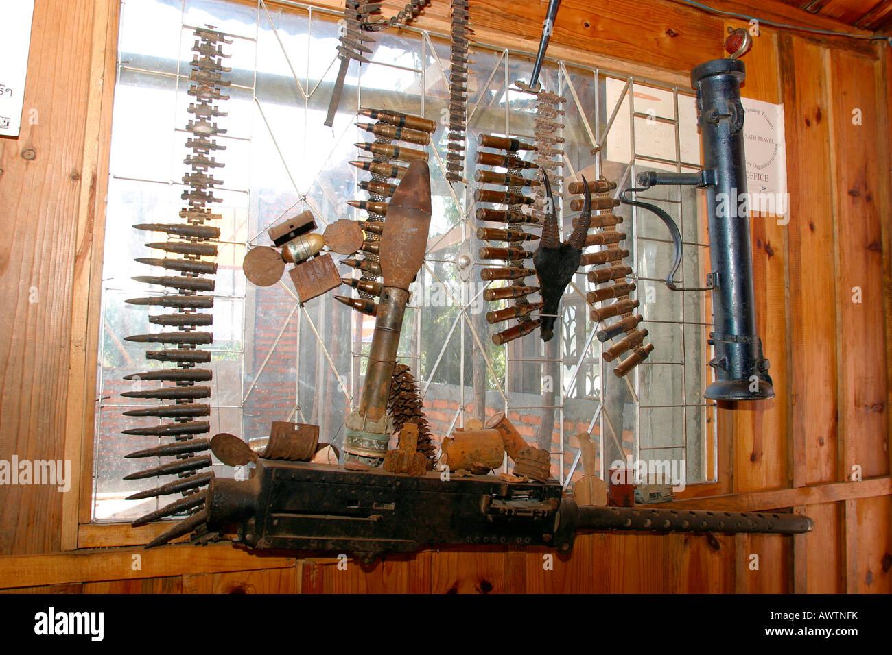 Laos Phonsavan Vietnam War armaments decorating guest house - Stock Image