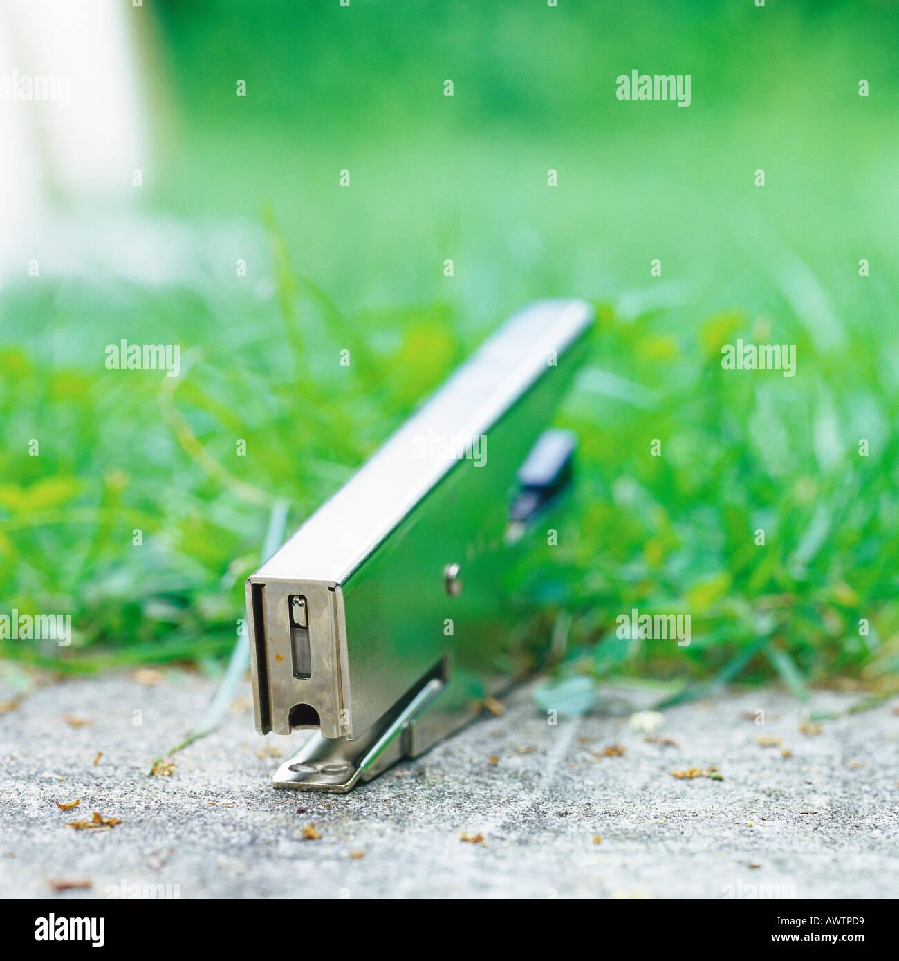 Stapler at edge of sidewalk - Stock Image