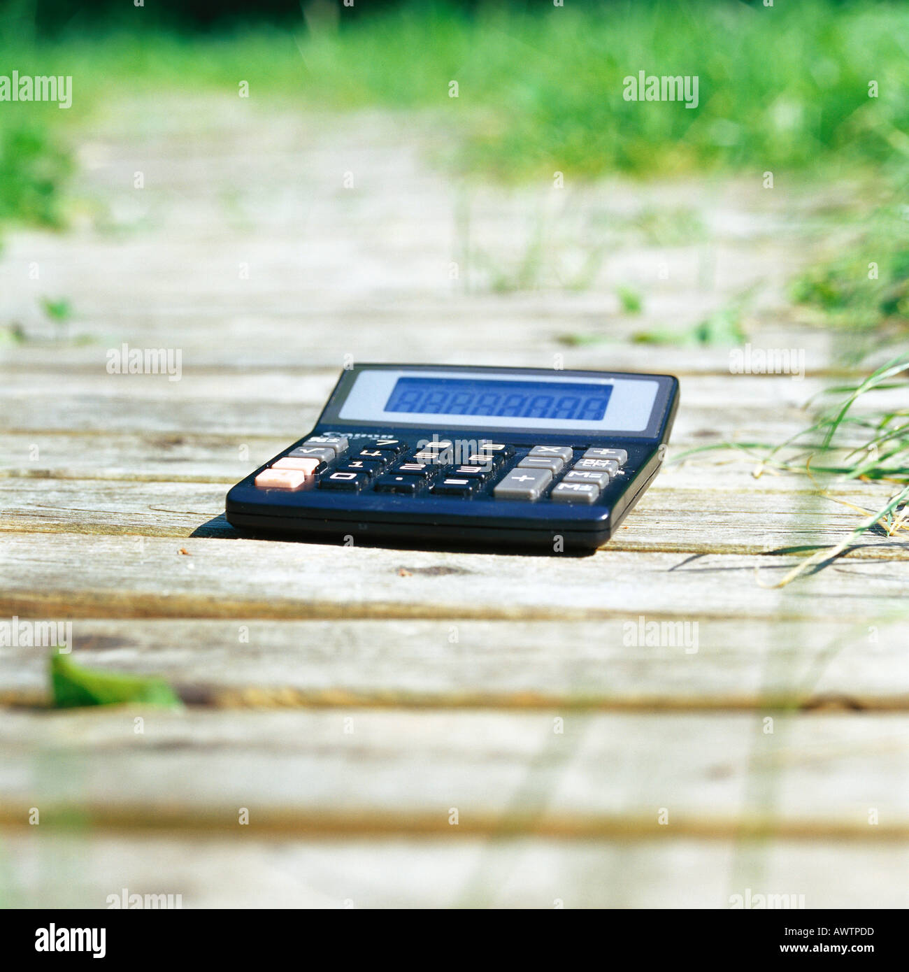 Calculator on path - Stock Image