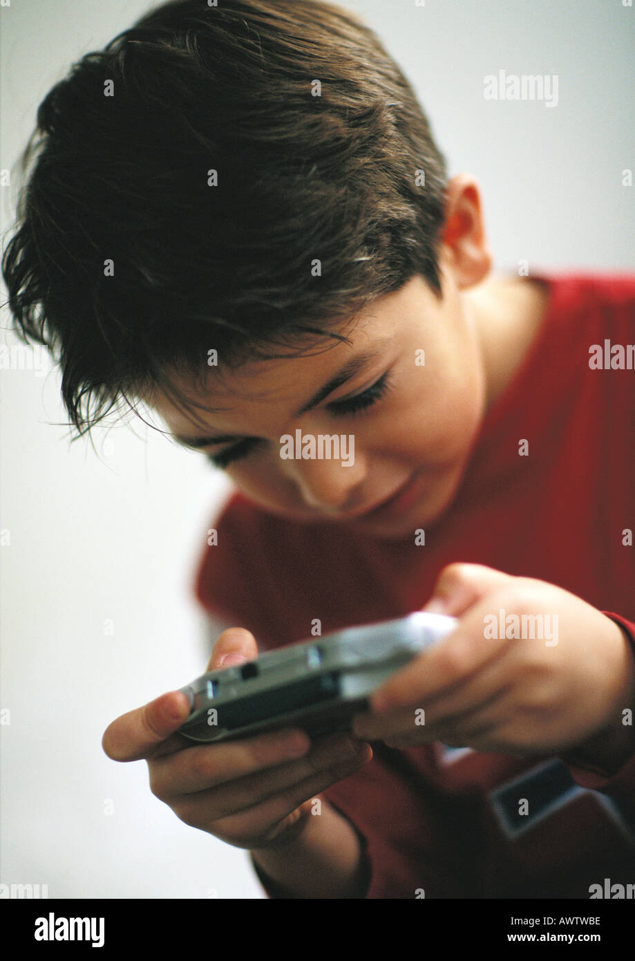 Young boy playing video game, close up Stock Photo