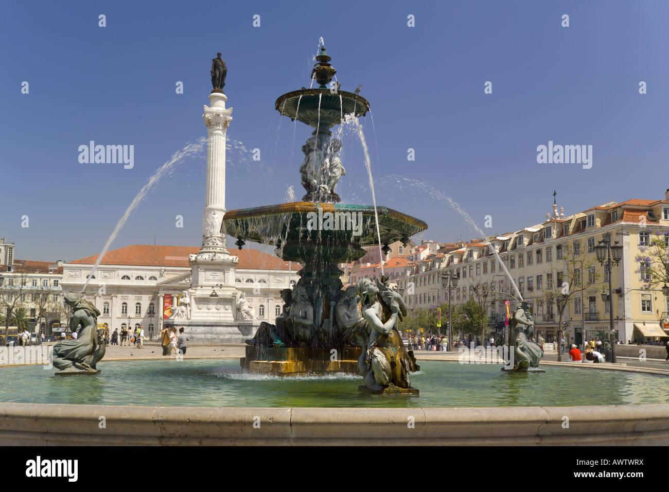 Portugal Lisbon the Baixa district Rossio Square fountain and the statue of Dom Pedro IV - Stock Image