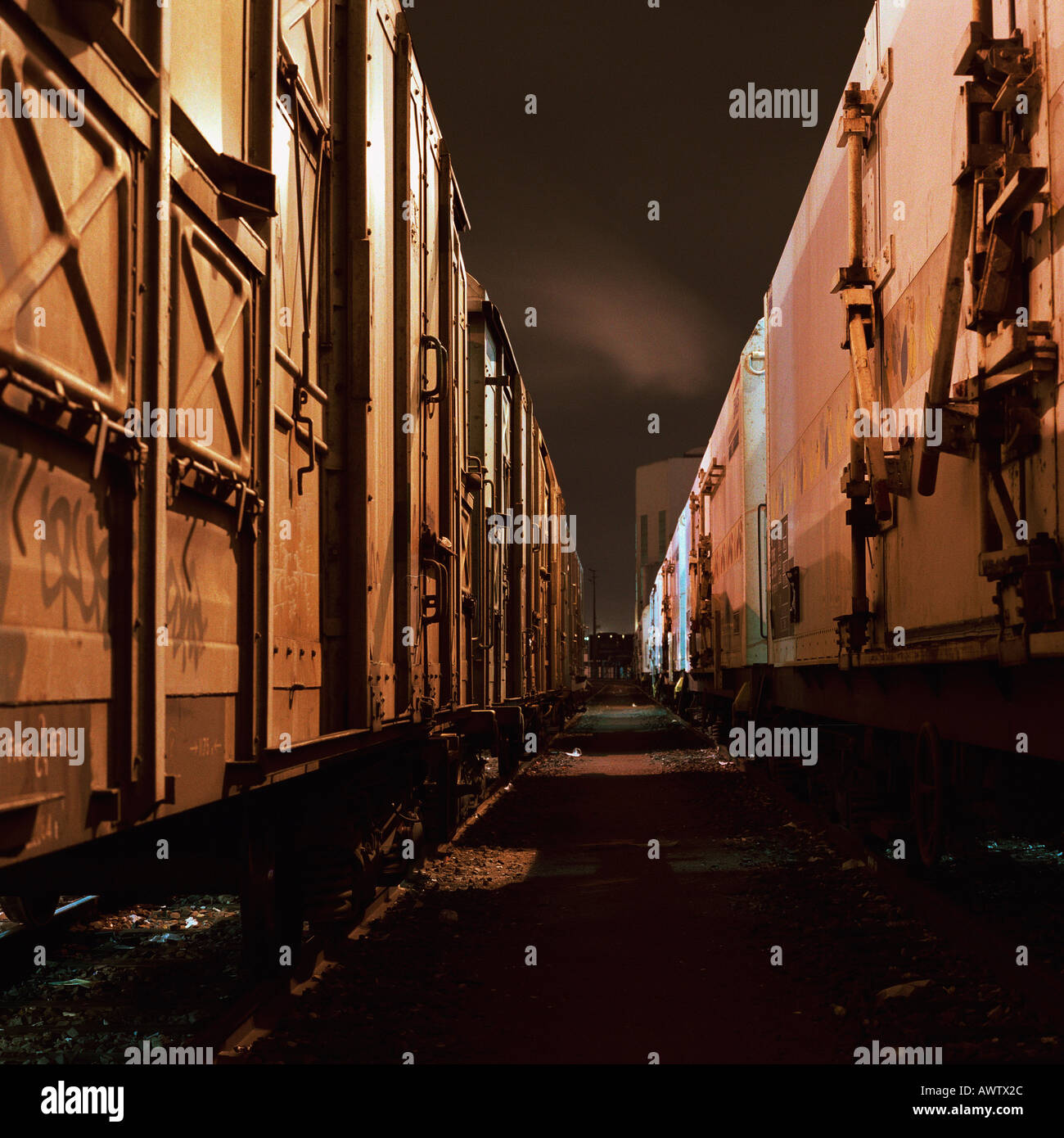 Freight trains at night, close-up - Stock Image
