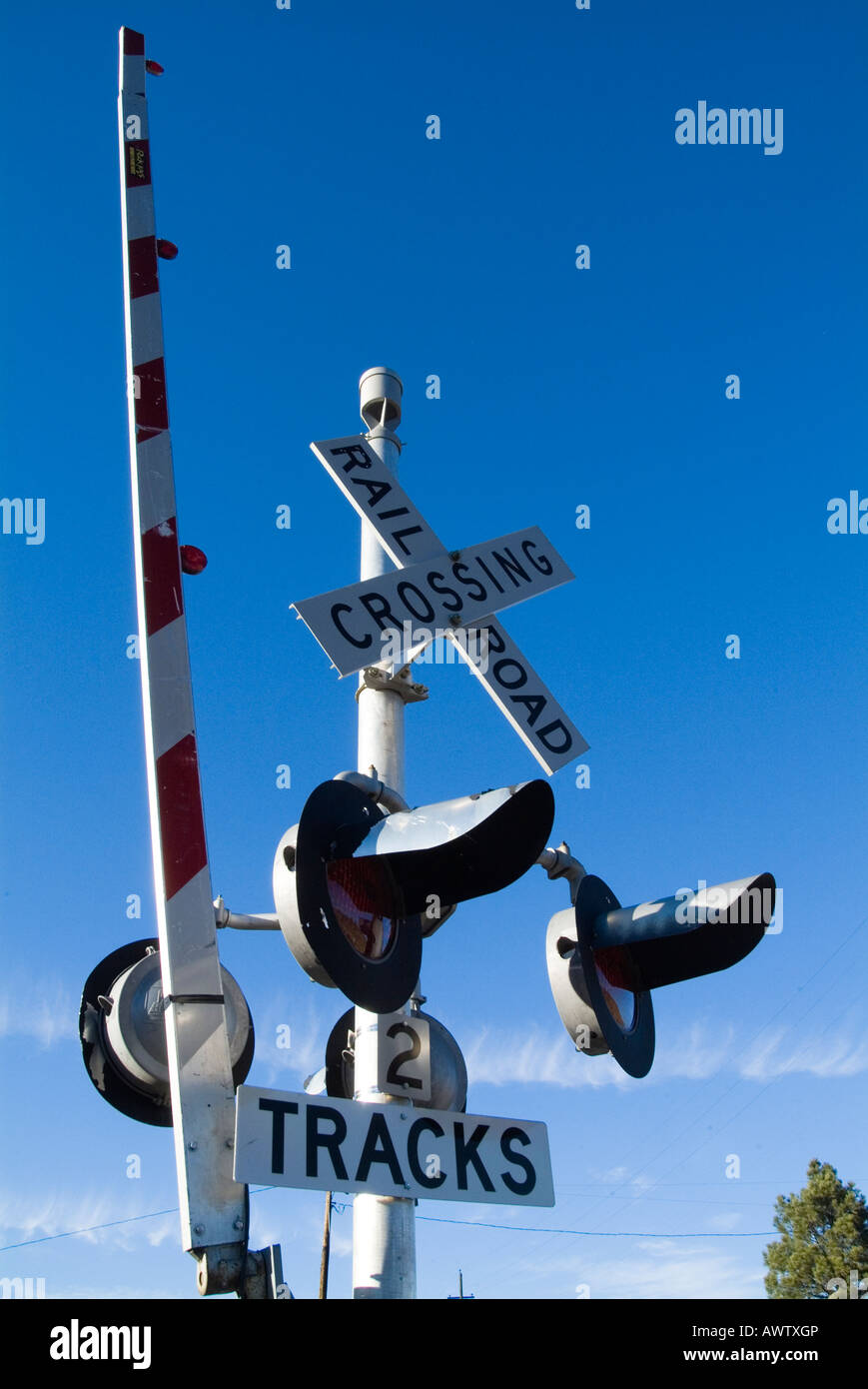 railway crossing sign track road lights barrier level crossing american america united states us usa - Stock Image