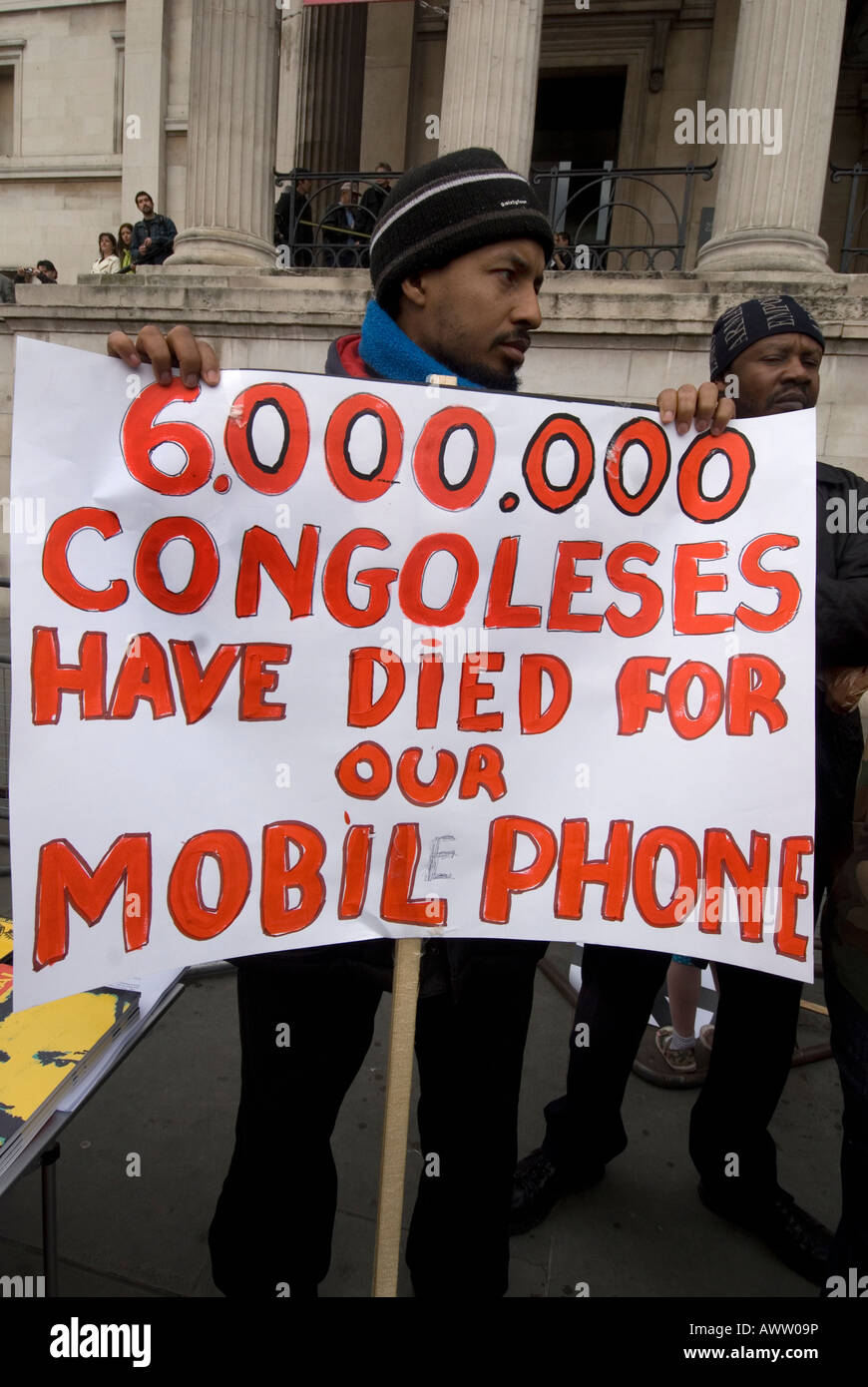 Congolese demonstrate to draw attention to the exploitation of their country for coltan used in mobile phones - Stock Image