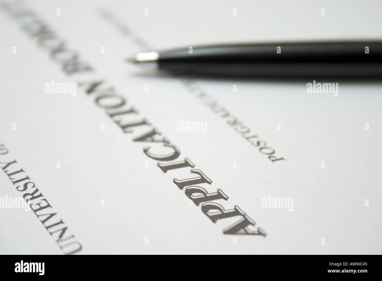 application form for university admission with pen - Stock Image