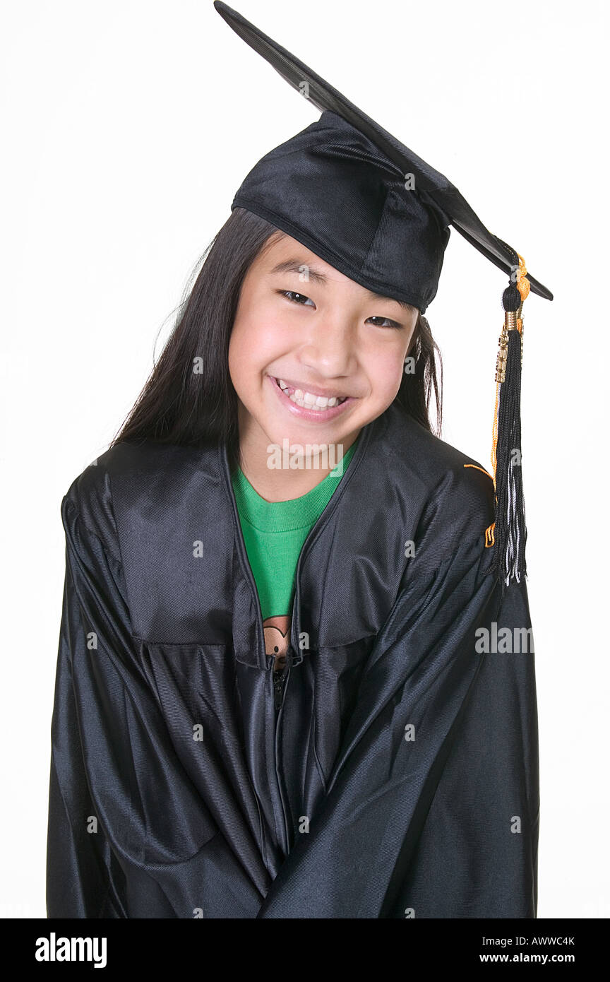 Young Girl Wearing Graduation Cap and Gown Stock Photo: 16659378 - Alamy