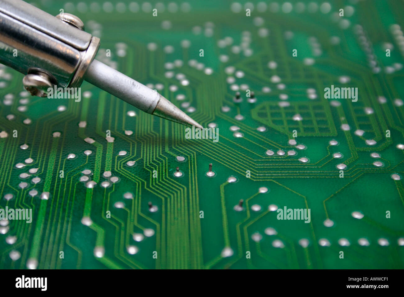 Repair Electronic Circuit Board With Soldering Iron