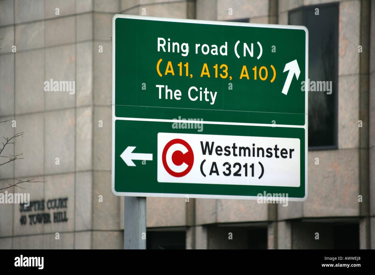 Road sign featuring congestion charging logo, London, England, UK. - Stock Image