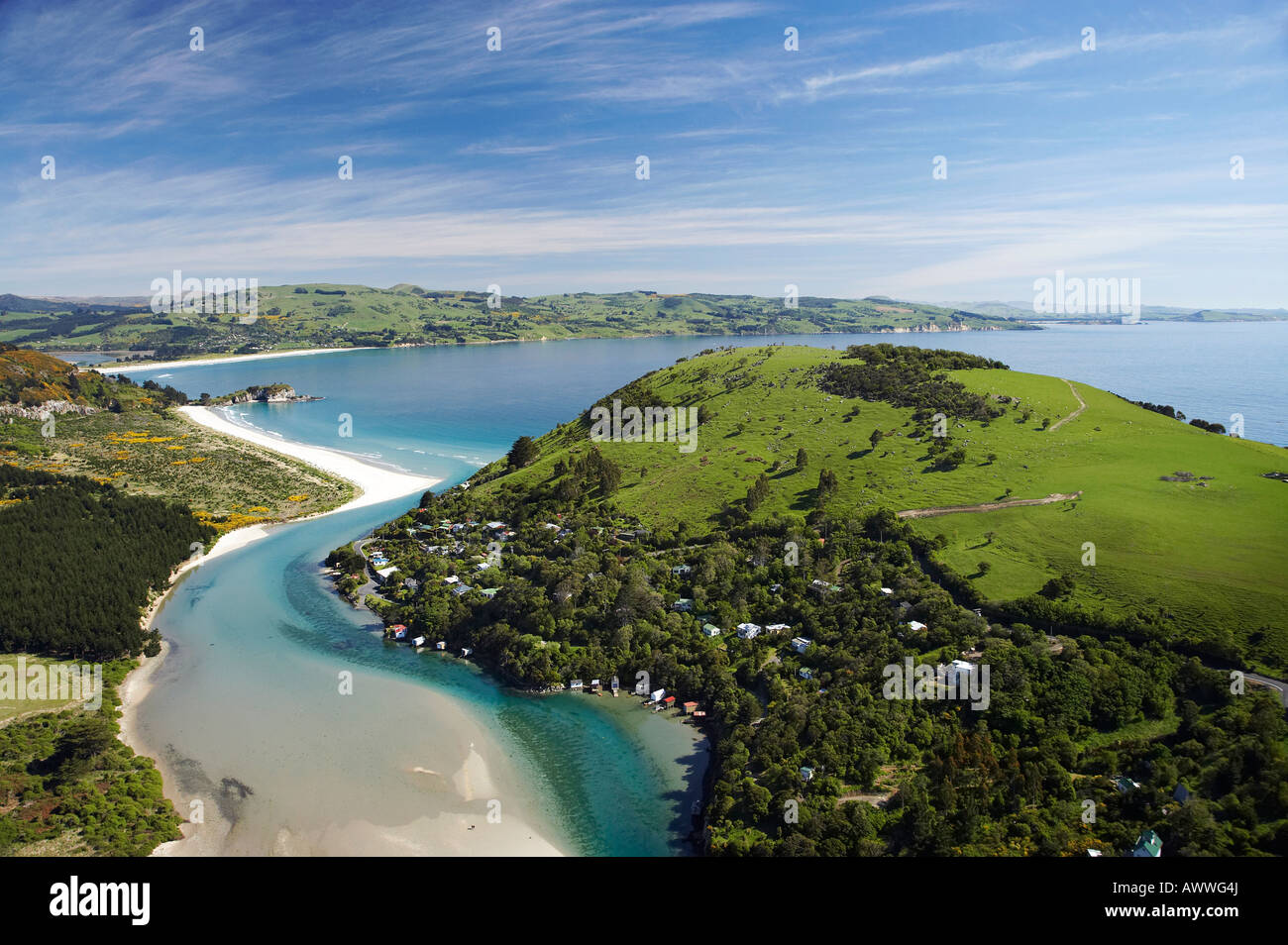 Purakanui Inlet Township and Bay north of Dunedin South Island New Zealand aerial Stock Photo