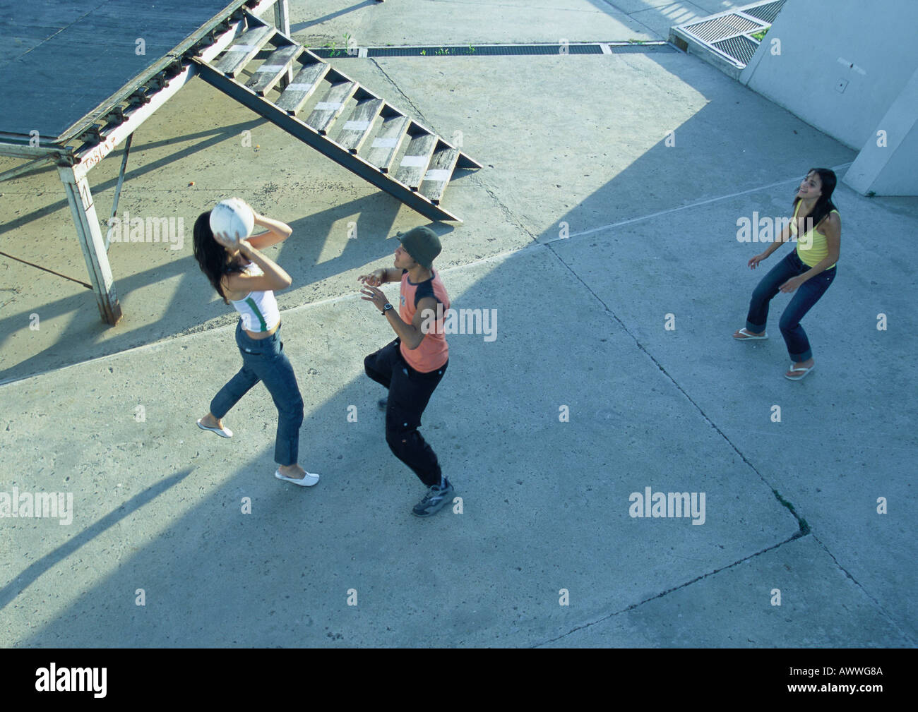 Young people playing with ball, high angle view - Stock Image