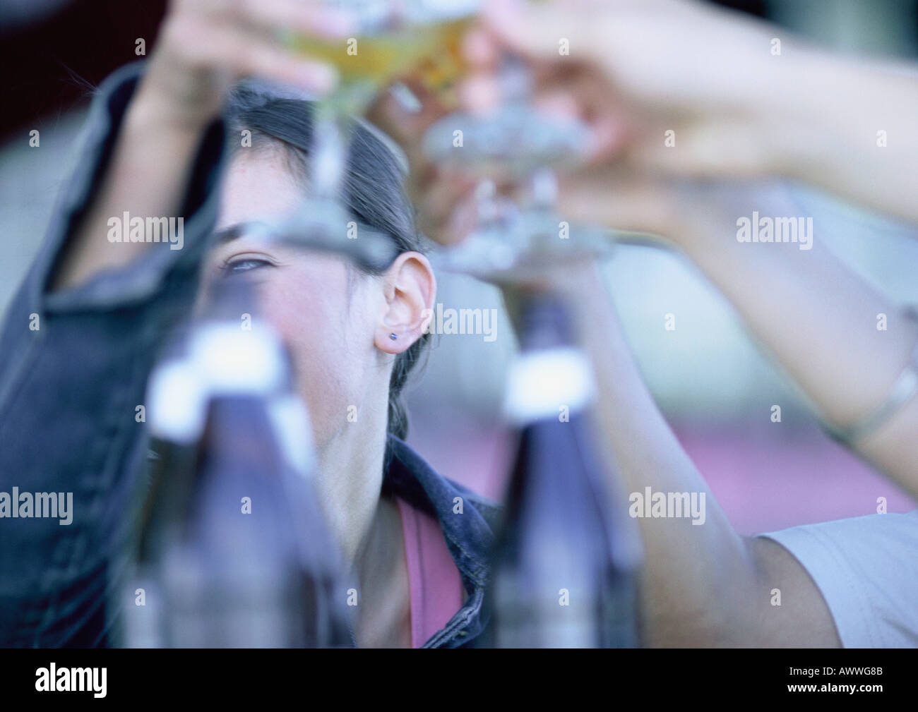 People clanking glasses together, close-up - Stock Image