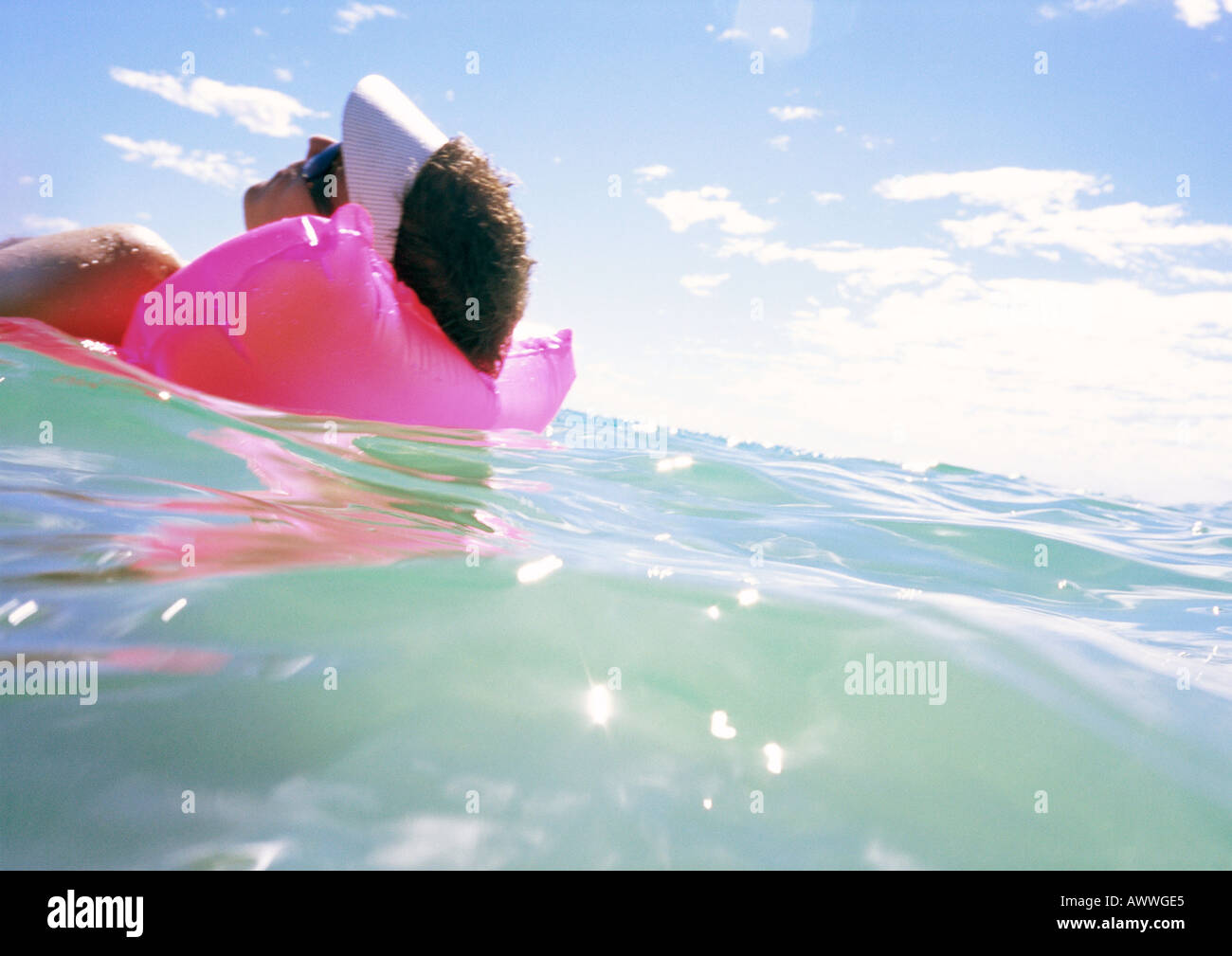 Man Floating On Air Mattress In Sea Close Up