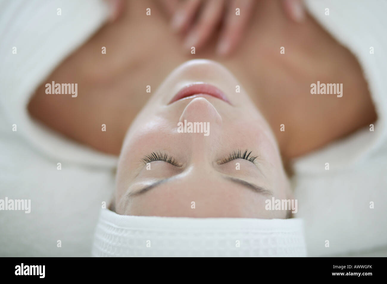 A woman relaxing at a beauty therapists - Stock Image