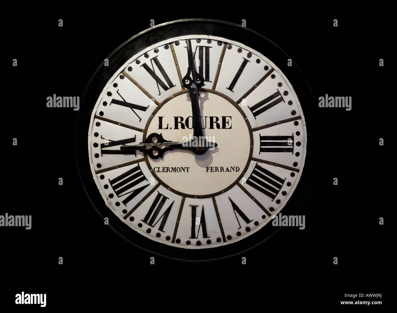 An old enamelled iron wall clock face (France). Cadran d'horloge ancienne en tôle émaillée (France). - Stock Image