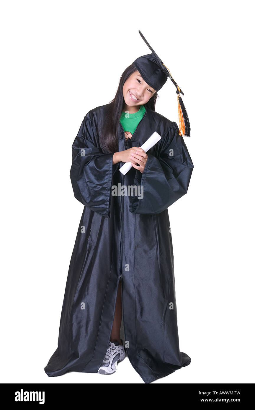 Girl in Graduation Gown Hugging Diploma Stock Photo: 16662216 - Alamy