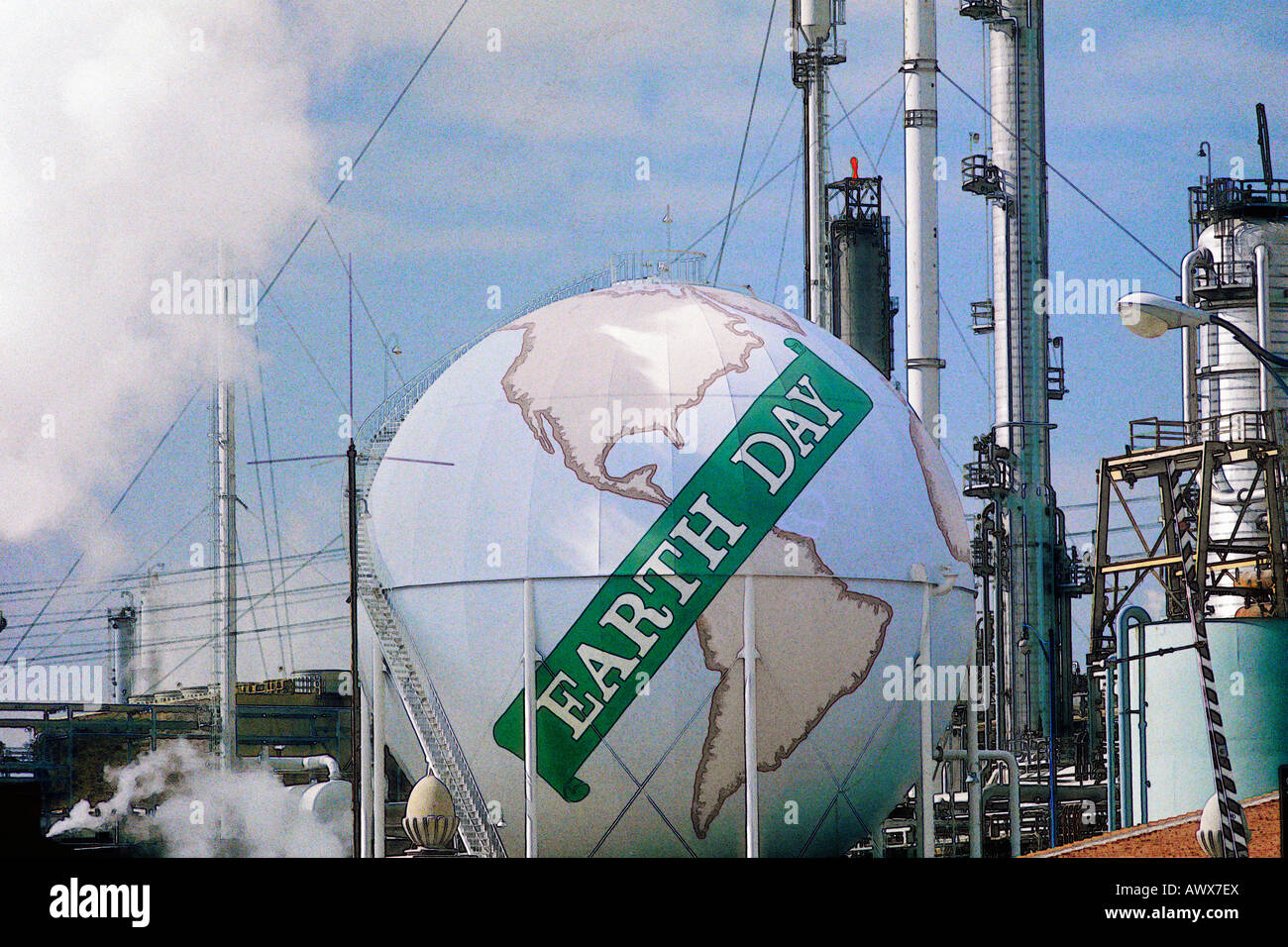 "Digitally altered view of a tank painted as a globe with the words ""Earth Day""  at a Unocal oil refinery in Los - Stock Image"