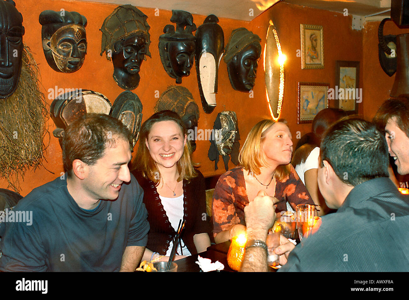 """PARIS France, Group Young Adults Chatting in African Theme Restaurant Bar """"L'Impala Lounge"""" Sitting around table Stock Photo"""