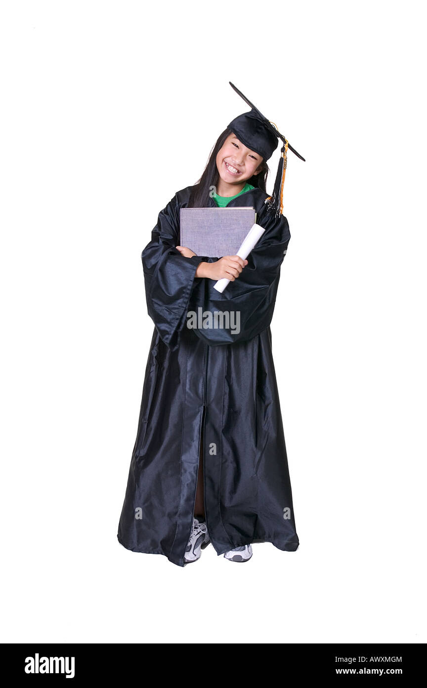 Girl in Graduation Gown Hugging Book and Diploma Stock Photo ...