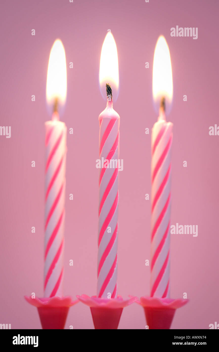 Three Birthday Candles On Pink Background