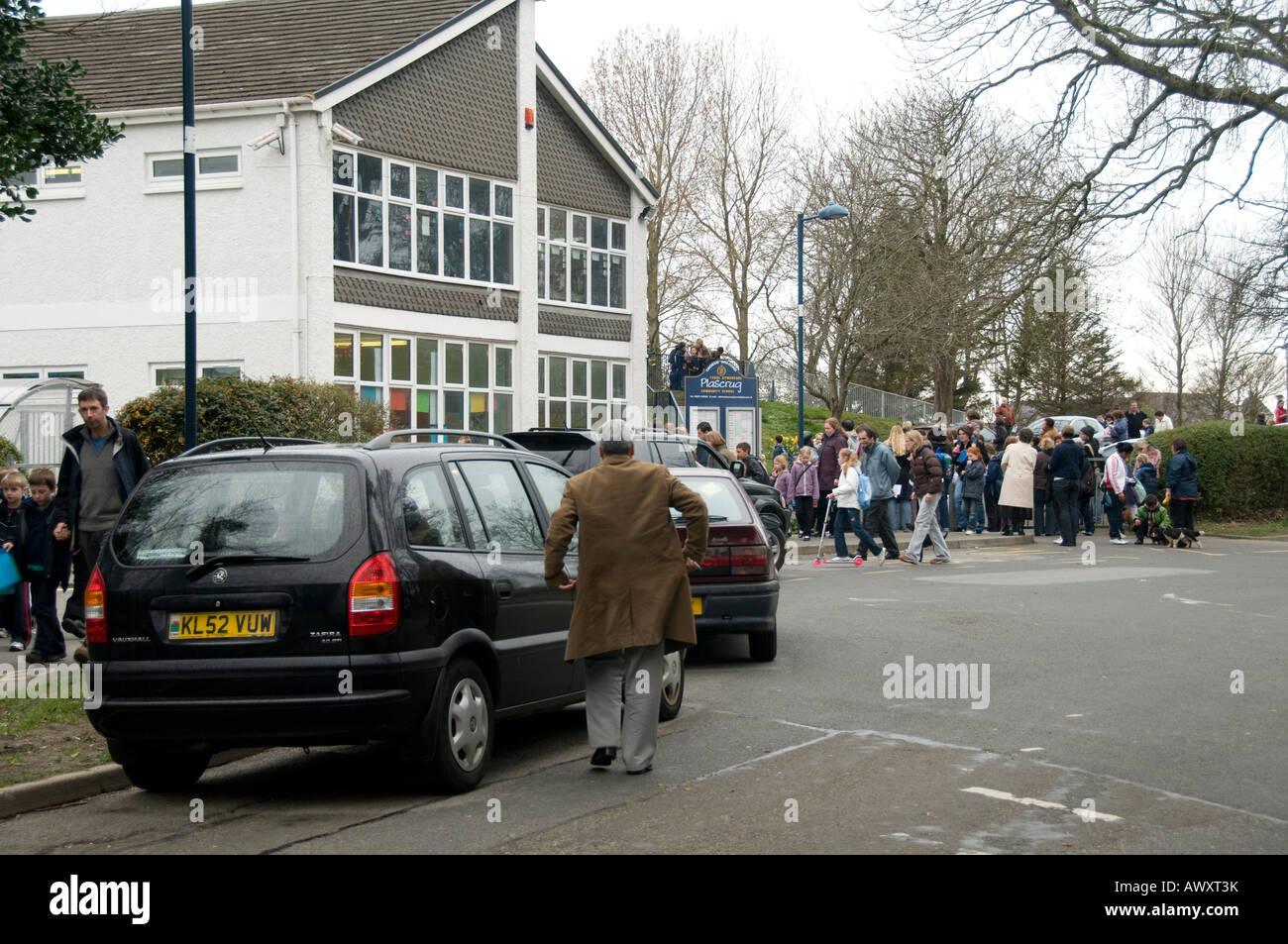 Parents in their cars collecting children from Plascrug primary school Aberystwyth Wales UK - Stock Image