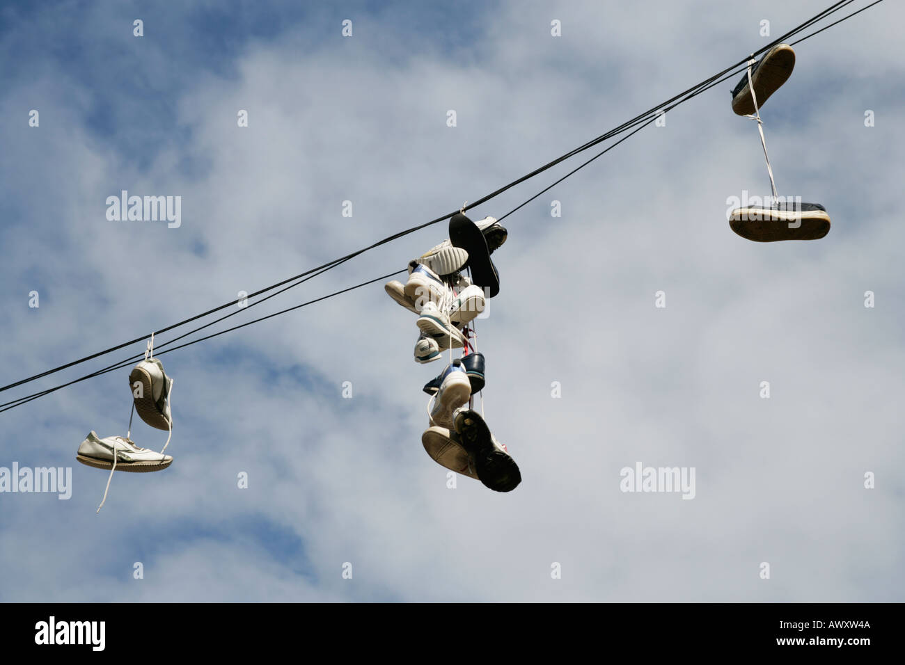 Shoes Hanging From Telephone Wire Stock Photos & Shoes Hanging From ...