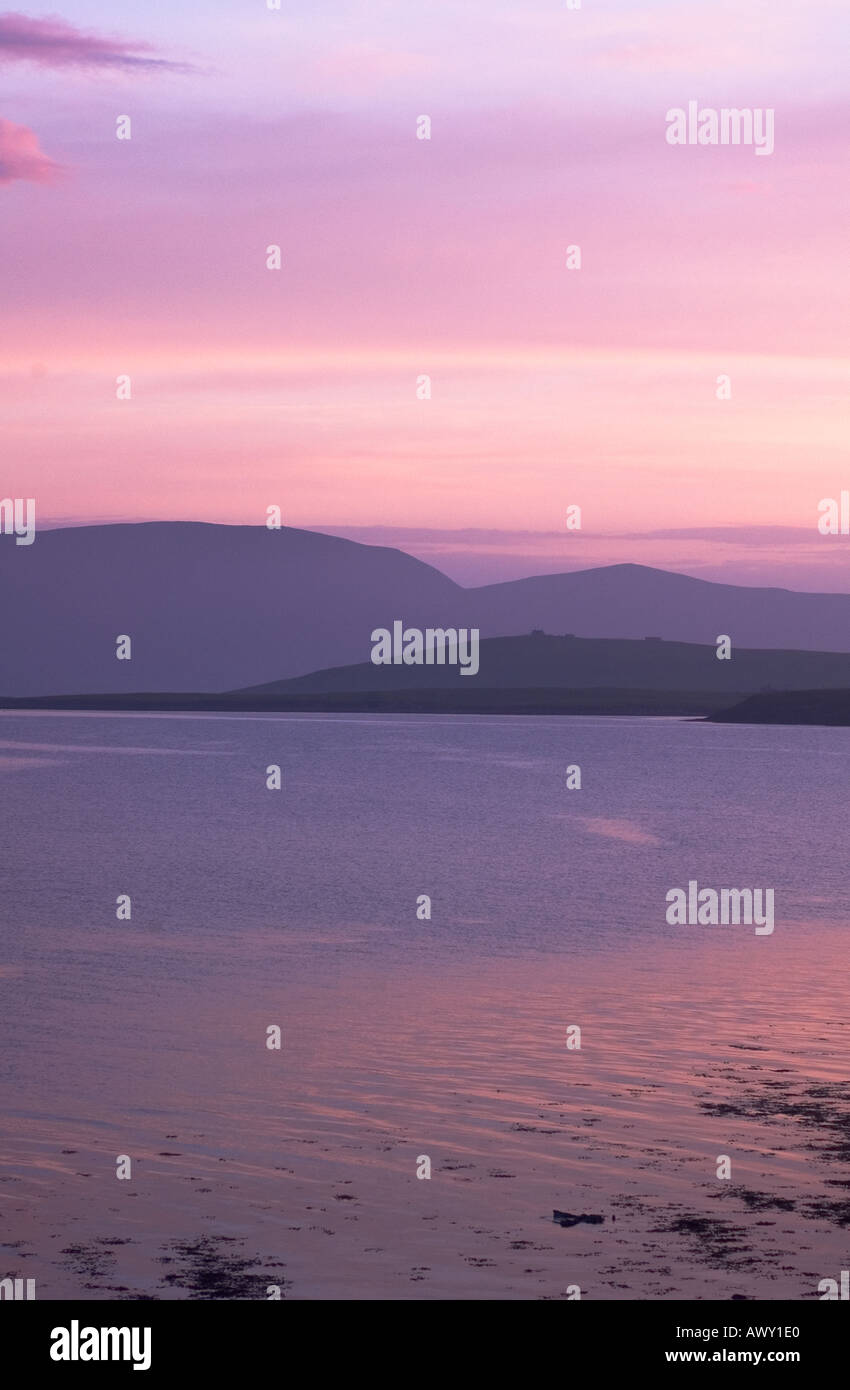 dh  SCAPA FLOW ORKNEY Misty sea Hoy hills lilac pink pastel evening light skies dusk sunset Stock Photo