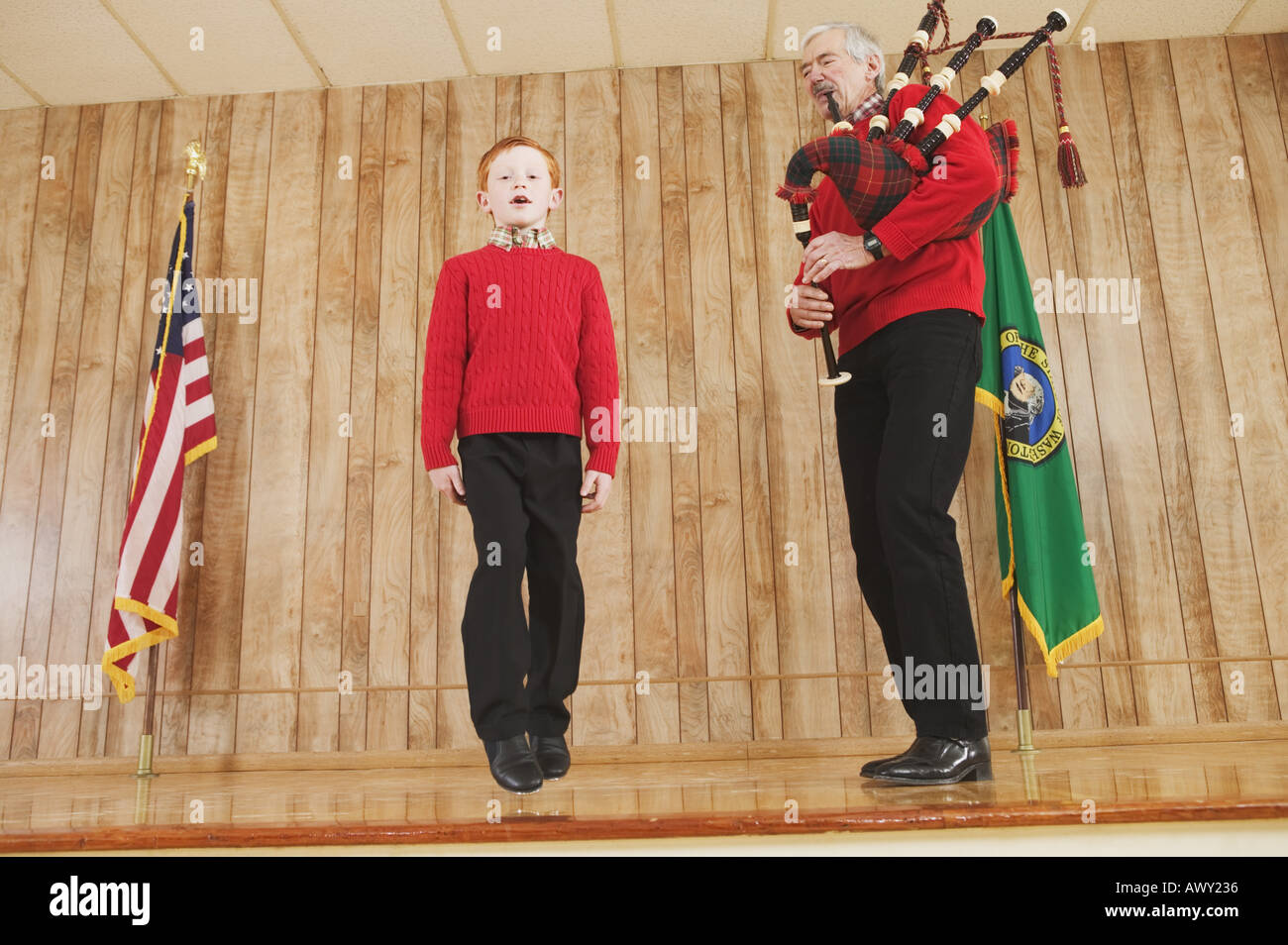 Young boy dancing to bagpipe music Stock Photo