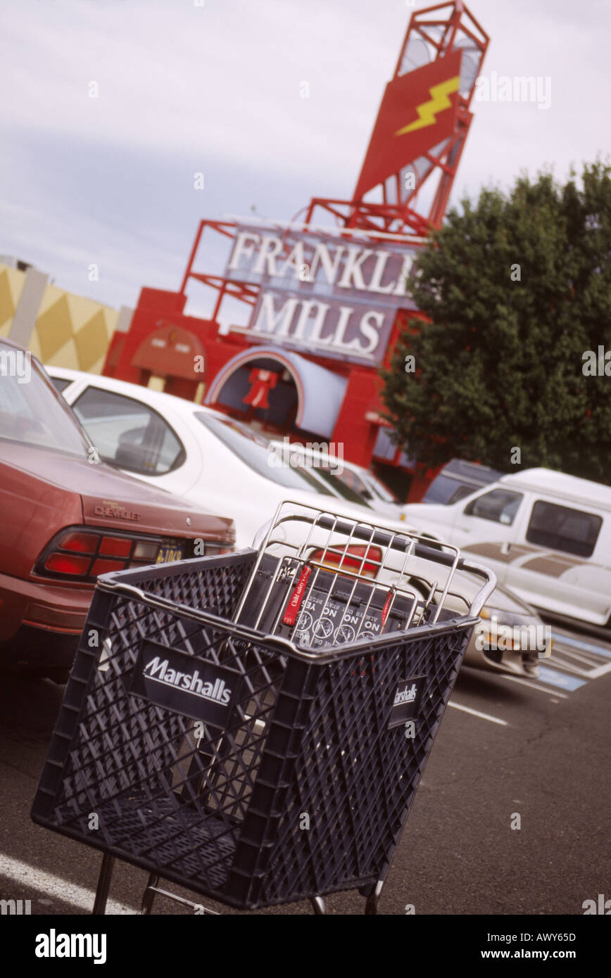 Empty trolley in the parking lot at Franklin Mills shopping mall in Philadelphia Pennsylvania USA - Stock Image