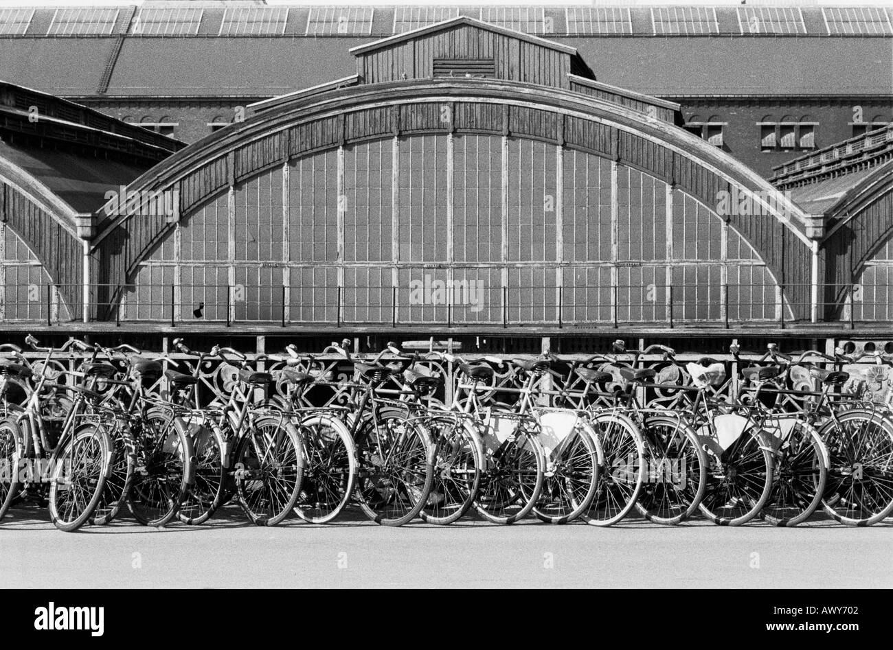 Bicycles parked outside Copenhagen railway station - Stock Image