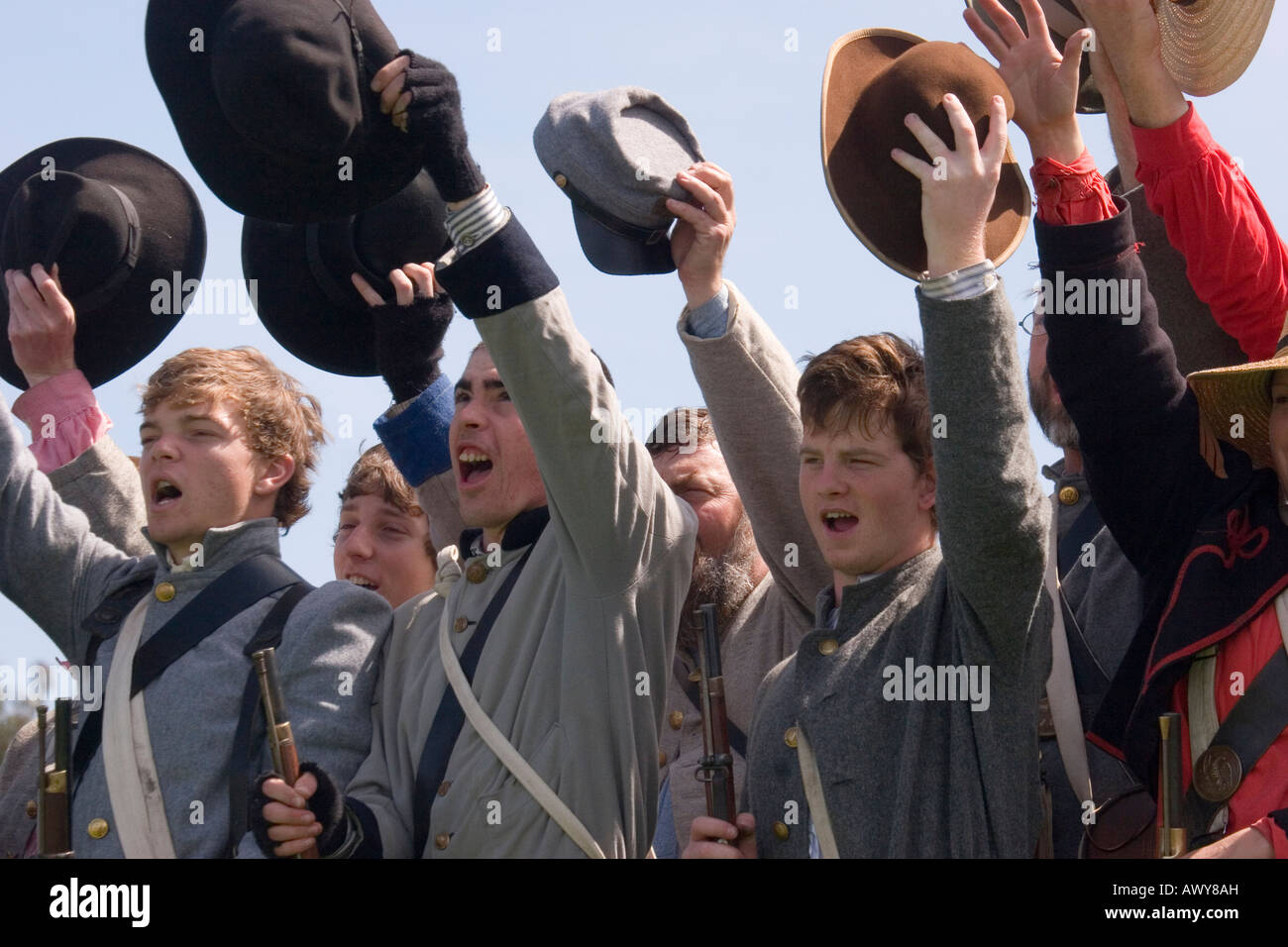 Teenagers dressed in authentic uniforms of young recruits from the Confederate Army in the American Civil War - Stock Image