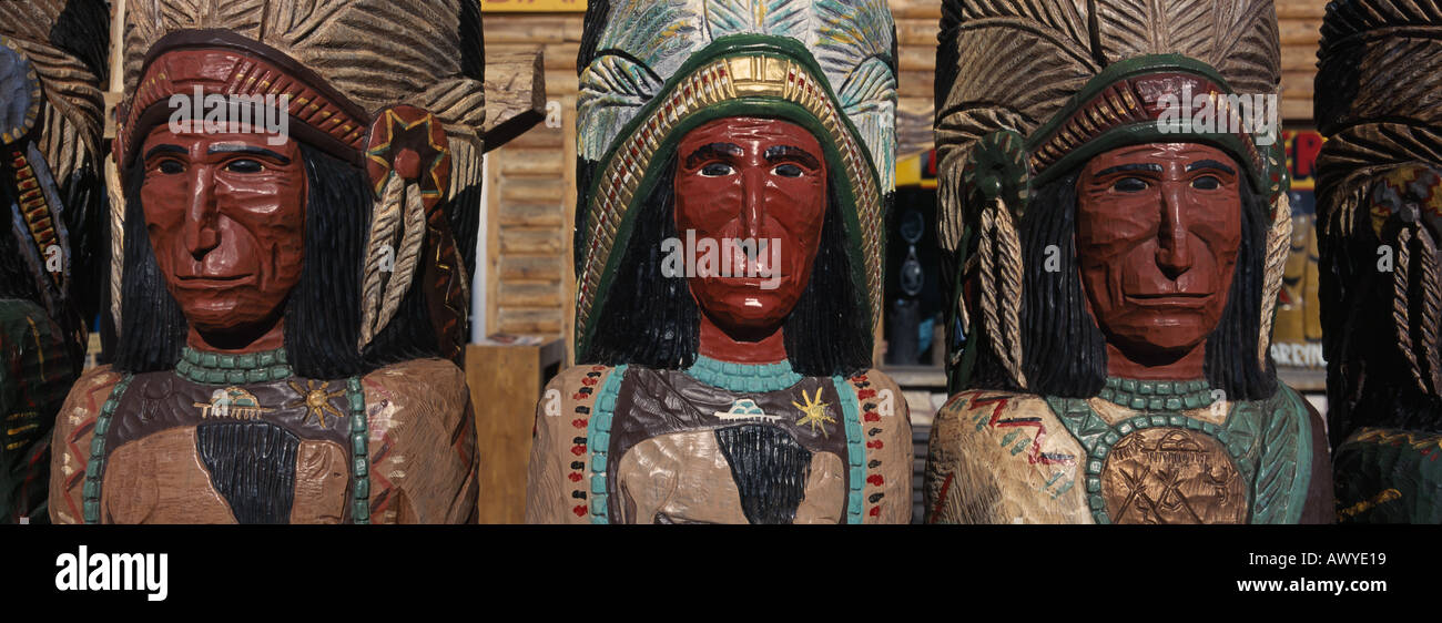 Three wooden life size cigar store wooden Indian carvings Jackson Hole Wyoming - Stock Image