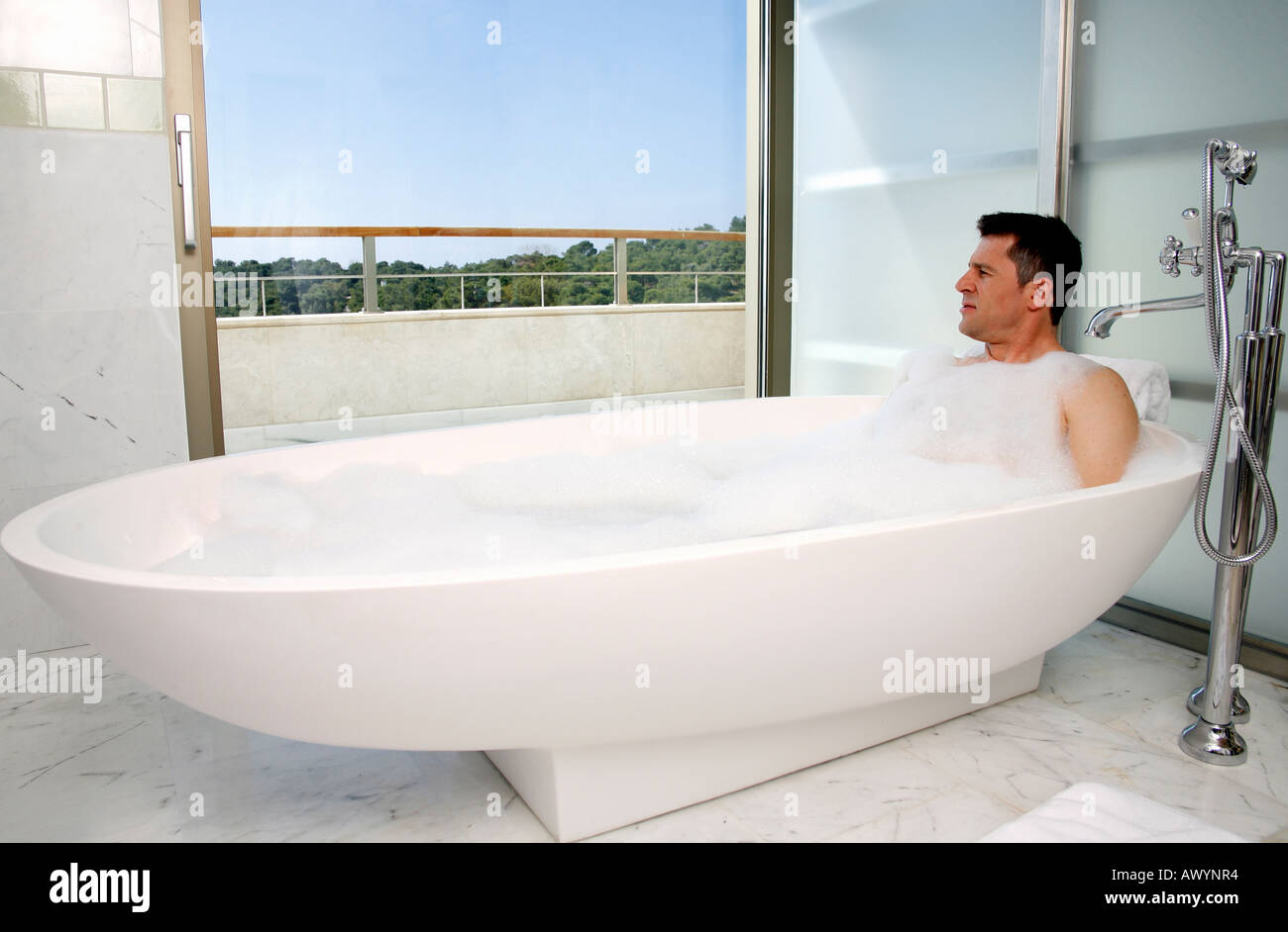 Man relaxing in bathtub with bubbles Stock Photo: 9532211 - Alamy