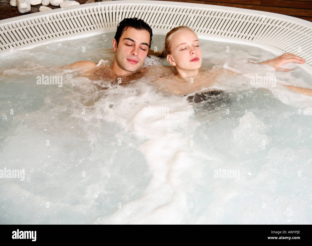 One man with one woman in jacuzzi at a spa Stock Photo: 9532333 - Alamy