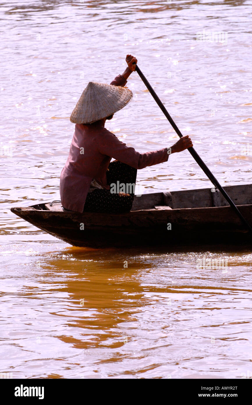 Vietnam Hoi An Market Young Woman In National Dress Non Bai Tho Conical Hat Paddles Boat On Thu Bon River At Dusk