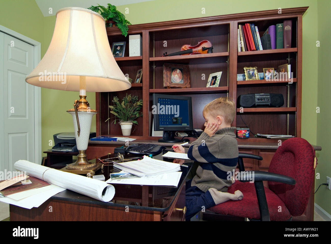 family home office. 5 Five Year Old Boy Works In The Family Home Office To Make A Birthday Card For His Mothers