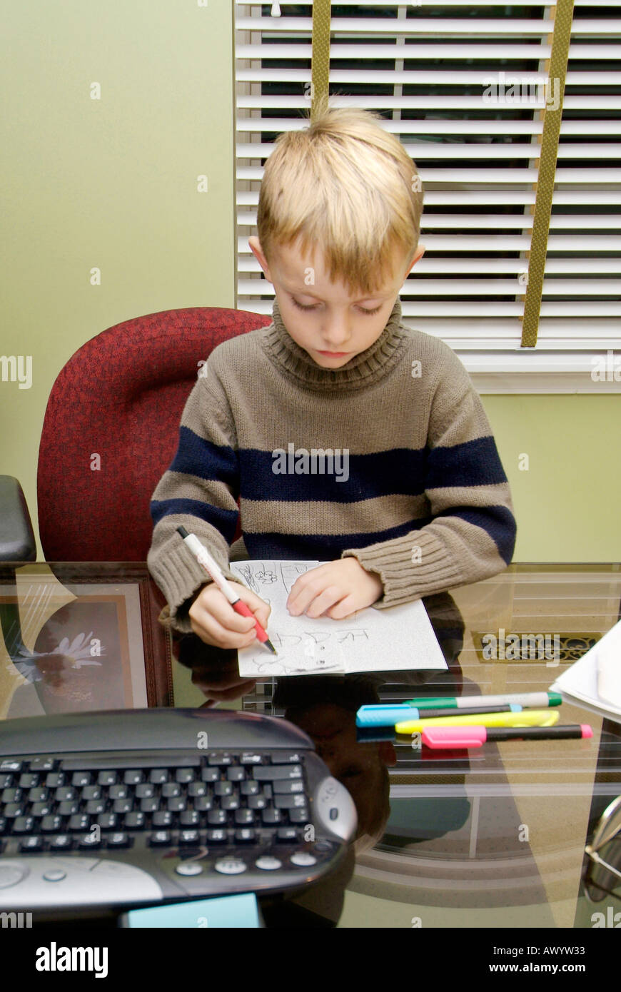 5 Five Year Old Boy Works In The Family Home Office To Make A Birthday Card For His Mothers