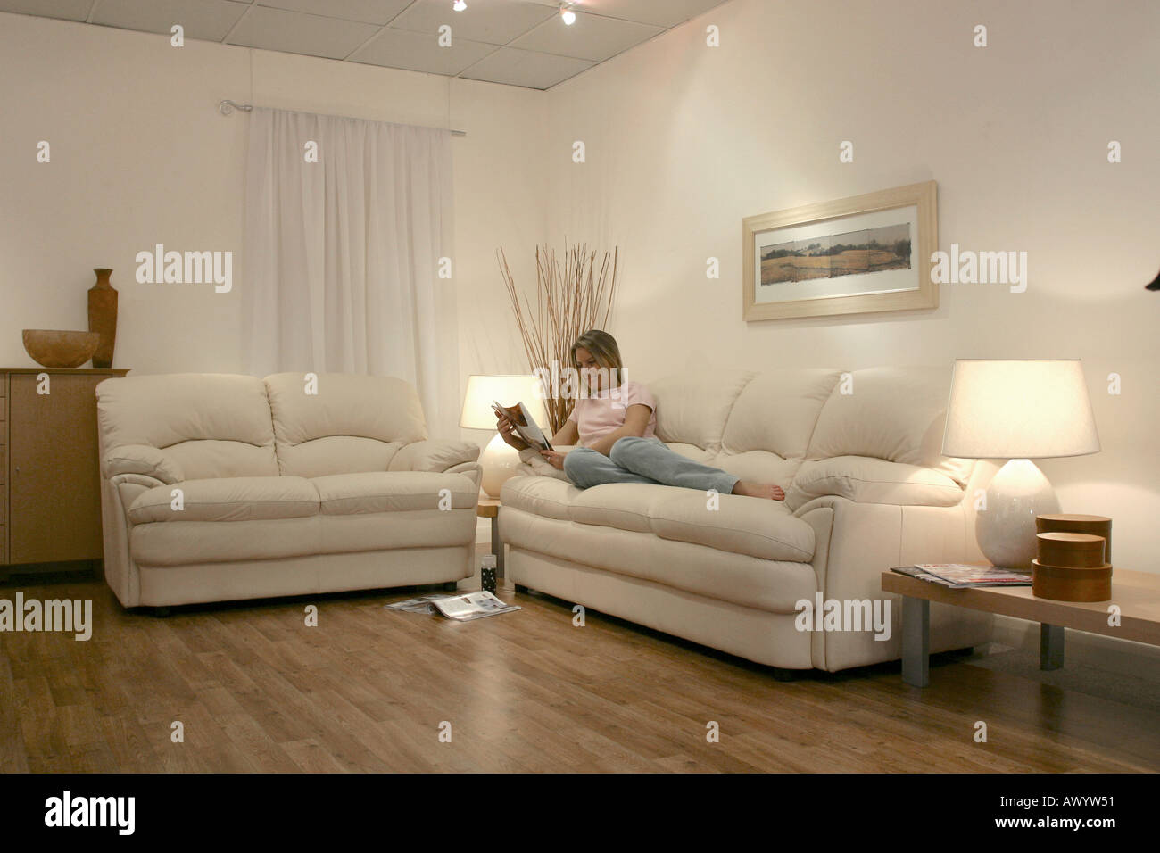 Two Settees and female model - Stock Image