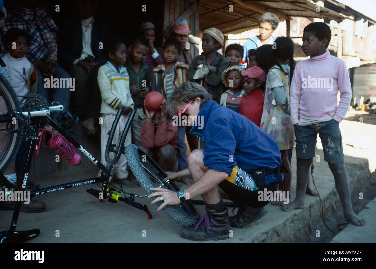Sean O'Kelly mending a puncture on his mountain bike during the Tran-Madagascan Mountain Biking Expedition Stock Photo