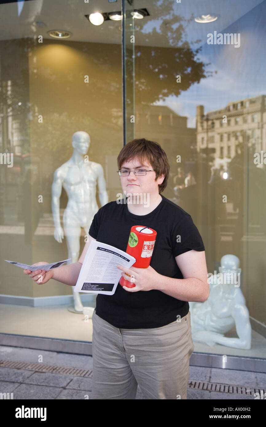 Dundee city, Scotland UK,  Overgate shopping centre and mall where young socialist is giving out recruiting leaflets. Stock Photo