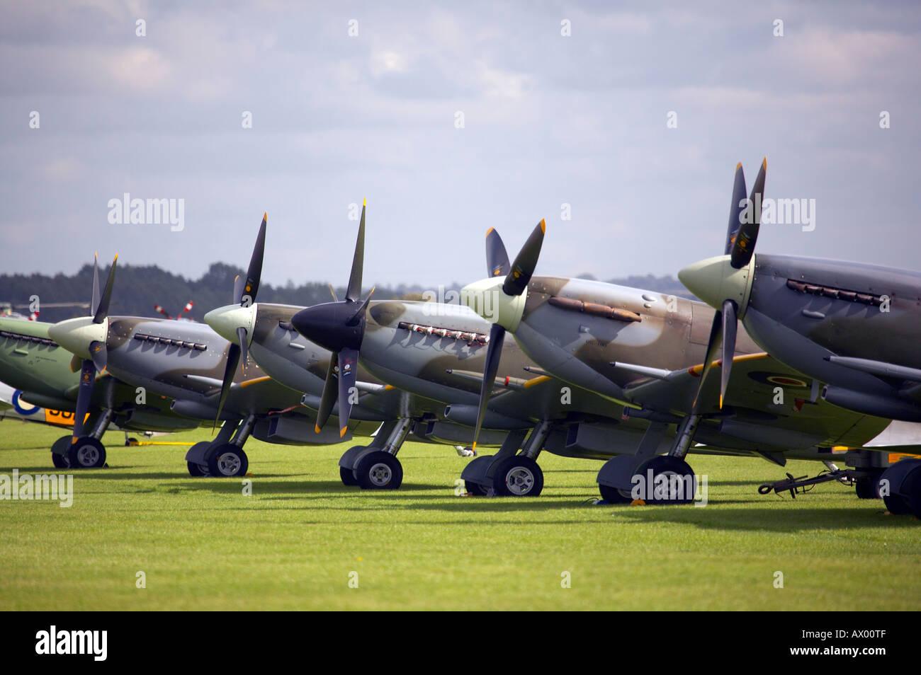 Line of Spitfires on runway at Duxford aerodrome UK - Stock Image