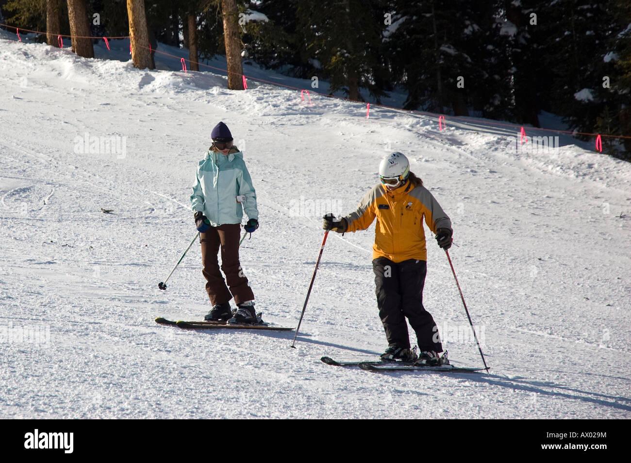 Student works with ski instructor, Arapahoe Basin Ski Area, Summit County, Colorado. - Stock Image