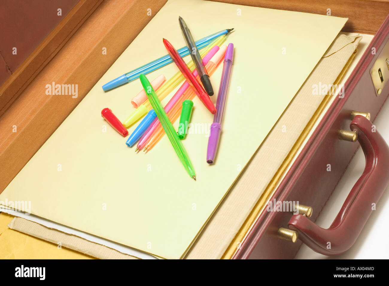 Ballpoint Pens and Files in Briefcase - Stock Image