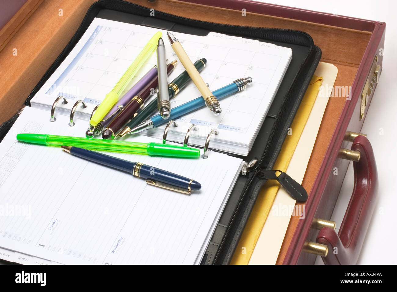 Pens and Organiser in Briefcase - Stock Image