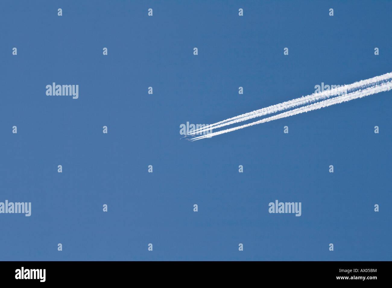 Jet air plane in blue sky above Borrowdale near Keswick Lake Dsitrict Cumbria - Stock Image