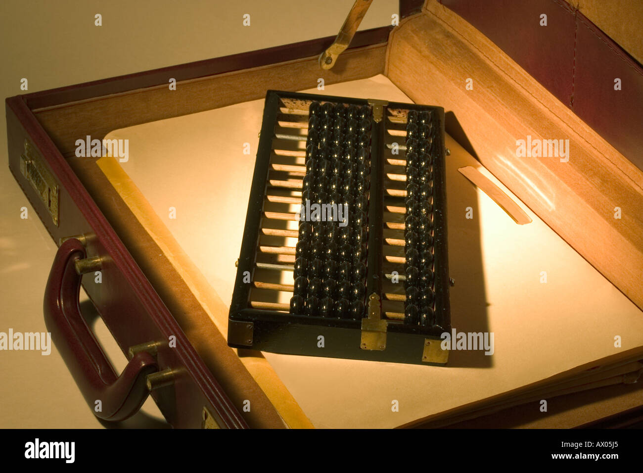 Abacus in Briefcase - Stock Image