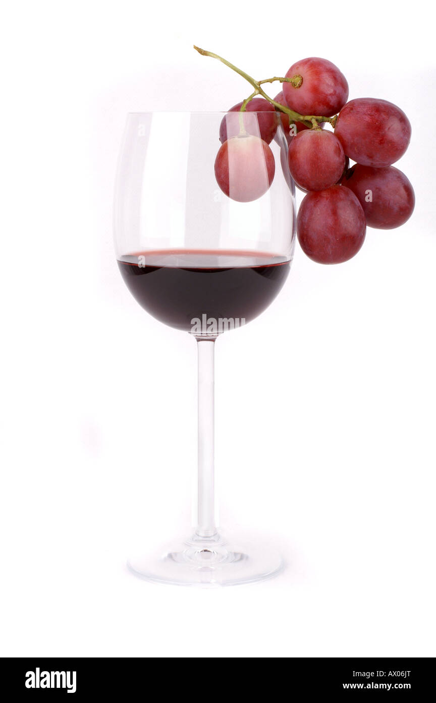 Detail of a glass of red wine and red grapes / Rotweinglas mit roten Trauben, Weintrauben Stock Photo