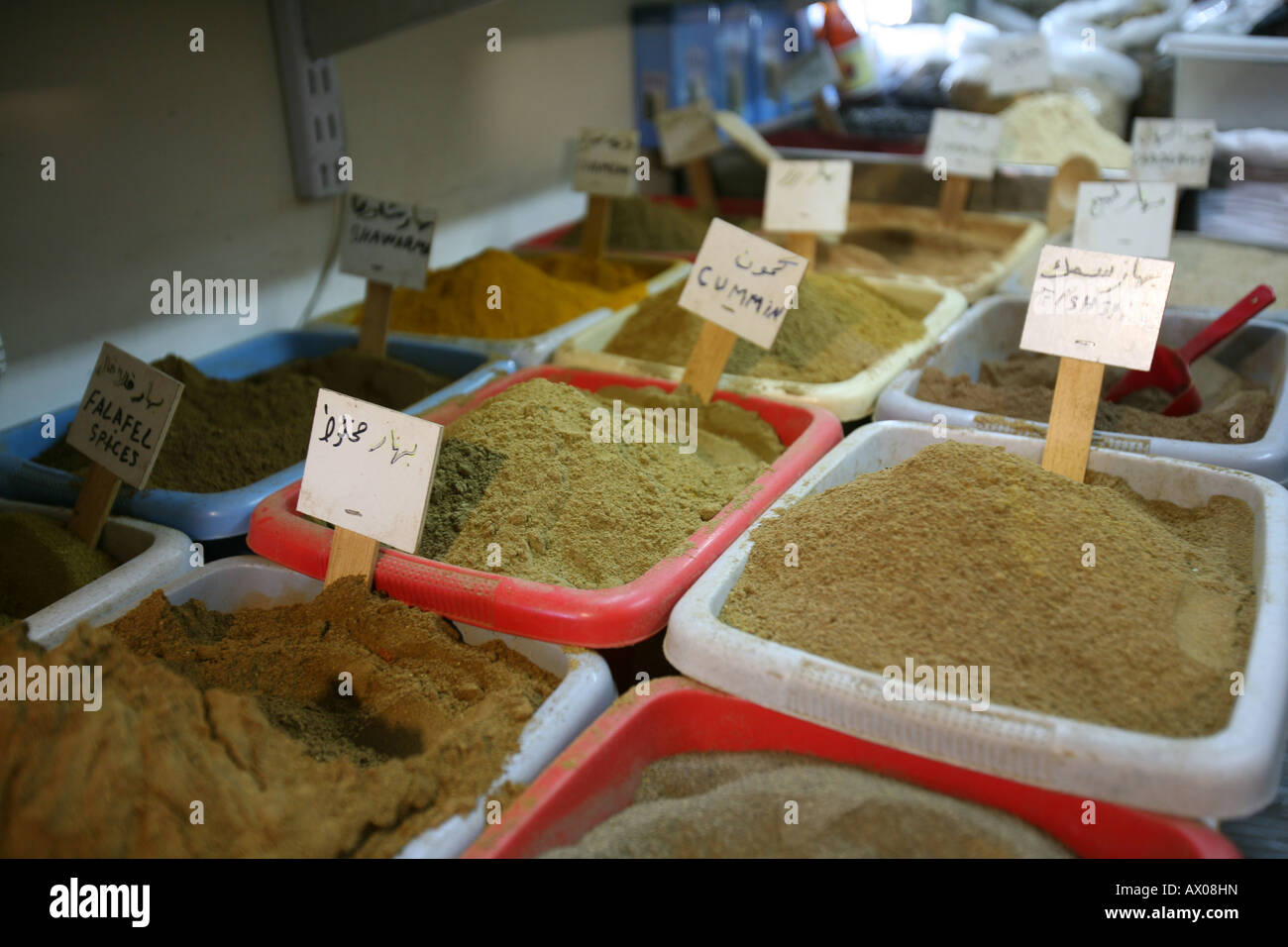 Spices and food for sale at a market in the old city section of Jerusalem - Stock Image